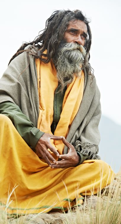 Hindu Yogi: Sadhu sitting calmly and gazing into distance.