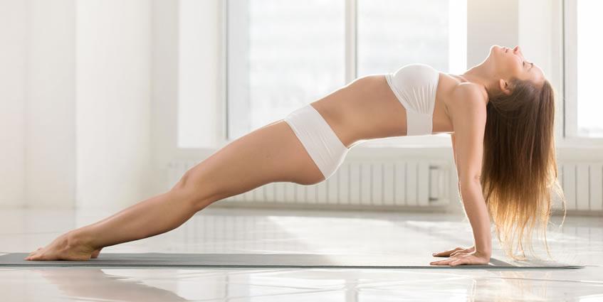 Solar Plexus Yoga Pose: Woman exercising Yoga in Purvottanasana Pose.
