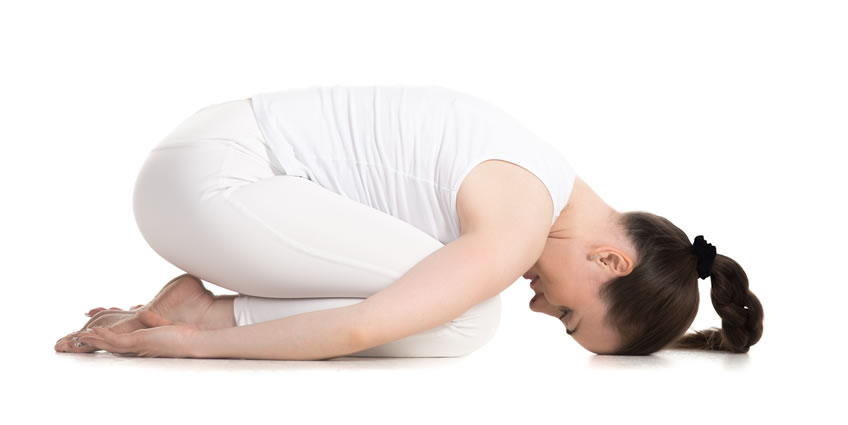 Third Eye Chakra Yoga Pose: Woman exercising Yoga in Balanasana Pose.