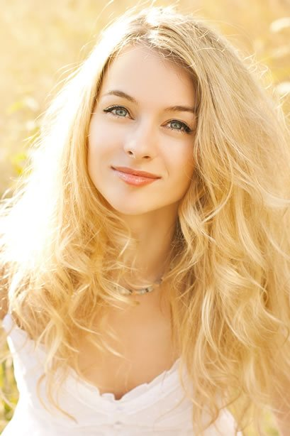 Portrait of Beautiful Young Woman with Blonde Hair.