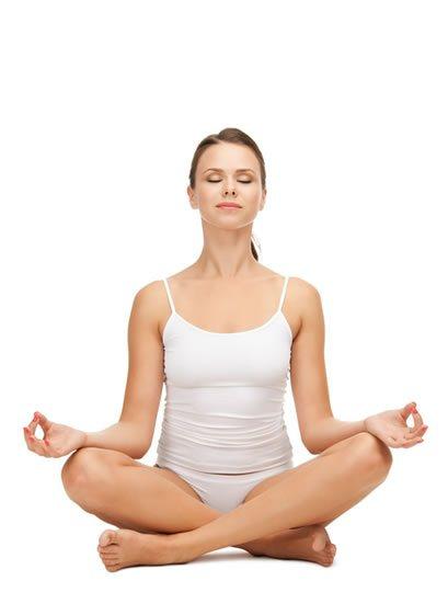 Yoga Sitting Pose: Woman sitting in Yoga Lotus Pose holding Hands in Dhyana Mudra Pose.
