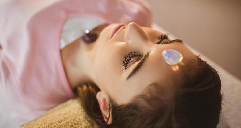 Placing Chakra Crystals on Body