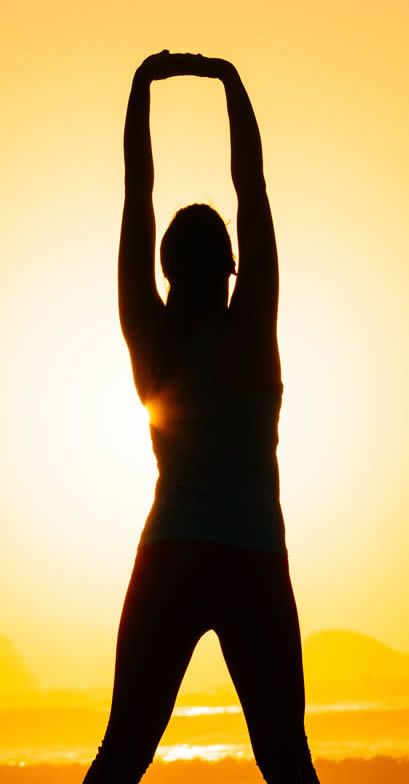 Solar Plexus Chakra Healing - Woman Stretching in the Sunset