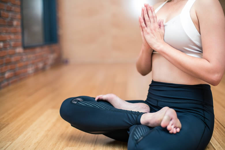 woman-meditating-in-her-home