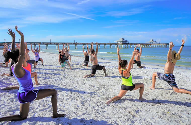 Outdoor Team Yoga on the Beach